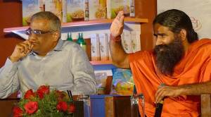 New Delhi: Yoga Guru Baba Ramdev with CEO of Future Group Kishore Biyani addressing a press conference in New Delhi on Friday. PTI Photo by Atul Yadav(PTI10_9_2015_000110A)
